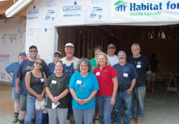City Staff and Community Members work on a  Habitat for Humanity Home.